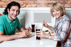 Couple enjoying dinner at a restaurant Royalty Free Stock Image