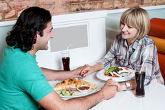 Couple enjoying dinner at a restaurant Royalty Free Stock Photo