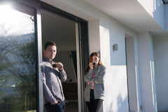 Couple enjoying on the door of their luxury home villa Royalty Free Stock Photography