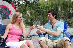 Couple enjoying drink. Couple enjoying a drink while camping Stock Images