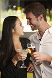 Couple Enjoying Drink In Bar Royalty Free Stock Images