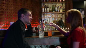 Couple Enjoying Drink In Bar stock video footage