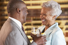 Couple Enjoying A Drink At A Bar Together stock images