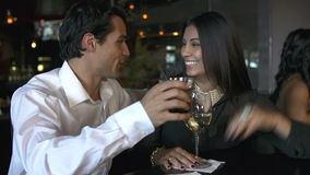 Couple Enjoying Drink At Bar Together stock video