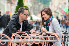 Couple enjoying a drink at restaurant Stock Photography