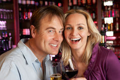 Couple Enjoying Drink Together In Bar stock photo