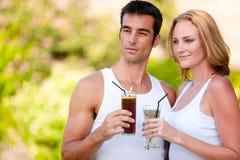 Couple Enjoying Drinks Royalty Free Stock Photos