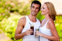 Couple Enjoying Drinks Stock Photography