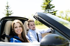 Couple enjoying a drive in a convertible royalty free stock images