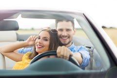 Couple enjoying a drive in a convertible Stock Photo