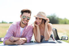 Couple enjoying a drive in a convertible Stock Photography