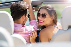 Couple enjoying a drive in a convertible Stock Images