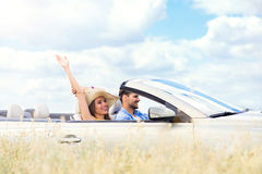 Couple enjoying a drive in a convertible Royalty Free Stock Photography