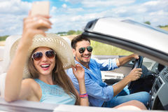 Couple enjoying a drive in a convertible Royalty Free Stock Image