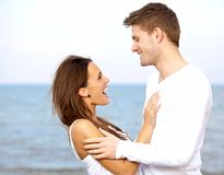 Couple Enjoying Each Other's Company at the Beach Stock Images