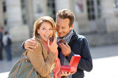 Couple enjoying eating pastries in town Stock Photo