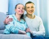Couple enjoying evening at home Stock Photography