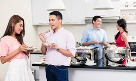 Couple enjoying the food at a house party royalty free stock photos