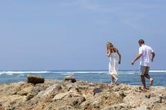 COUPLE ENJOYING FREEDOM ON THE BEACH Royalty Free Stock Photo