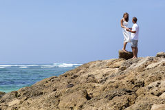 COUPLE ENJOYING FREEDOM ON THE BEACH Royalty Free Stock Photos