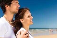 Couple enjoying freedom on the beach Stock Images
