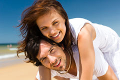Couple enjoying freedom on the beach Royalty Free Stock Image