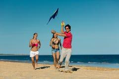 Couple enjoying freedom on the beach Stock Image