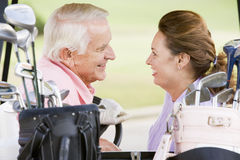 Couple Enjoying A Game Of Golf Royalty Free Stock Images
