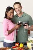 couple enjoying glass kitchen wine young Στοκ Εικόνες