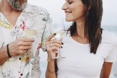 Couple enjoying a glass of wine by the beach stock photography
