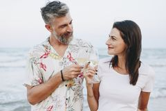 Couple enjoying a glass of wine by the beach stock photos