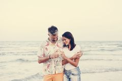 Couple enjoying a glass of wine by the beach royalty free stock photography