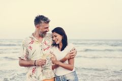 Couple enjoying a glass of wine by the beach royalty free stock image