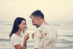 Couple enjoying a glass of wine by the beach royalty free stock photo