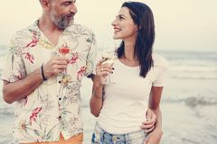 Couple enjoying a glass of wine by the beach stock images