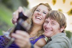 A Couple Enjoying A Glass Of Wine in the Park Royalty Free Stock Photos
