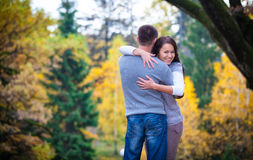 Couple enjoying golden autumn fall season Royalty Free Stock Image