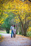 Couple enjoying golden autumn fall season Stock Images
