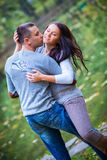 Couple enjoying golden autumn fall season Stock Photos