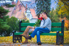 Couple enjoying golden autumn fall season Stock Images