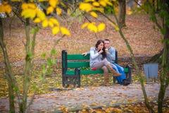 Couple enjoying golden autumn fall season Royalty Free Stock Image