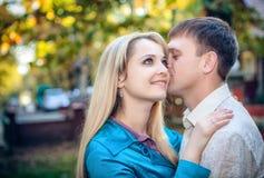 Couple enjoying golden autumn fall season Royalty Free Stock Photos