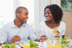 Couple enjoying a healthy meal together smiling at each other Royalty Free Stock Photos
