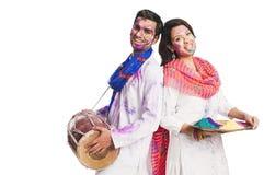 Couple enjoying holi Stock Image