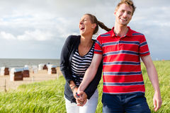 Couple enjoying holiday in beach dune Royalty Free Stock Images