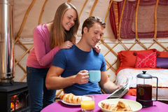 Couple Enjoying Holiday Camping In Traditional Yurt Royalty Free Stock Photography