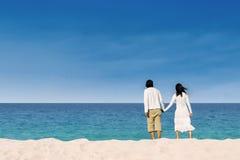 Couple enjoying honeymoon at the beach stock photo