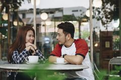 Couple enjoying hot drink at cafe. Couple enjoying a hot drink at cafe together Stock Photos