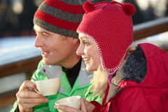 Couple Enjoying Hot Drink In Cafe At Ski Resort Stock Photography