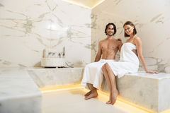 Couple enjoying hot sauna Stock Images